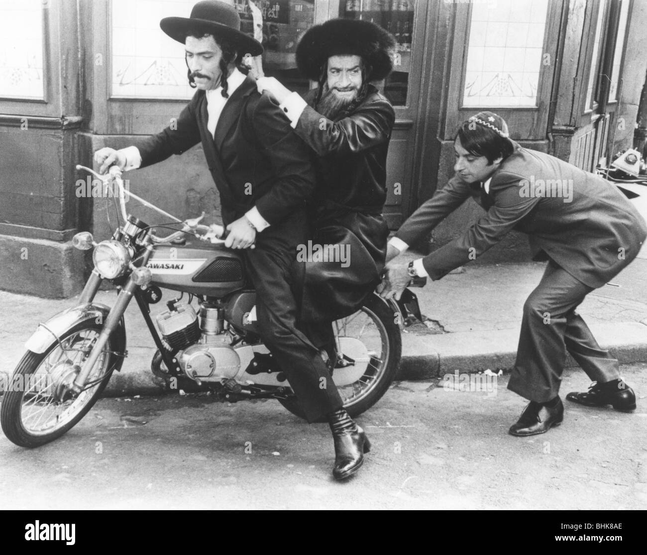 Motorbike chase scene from The Mad Adventures of Rabbi Jacob, 1973. - Stock Image