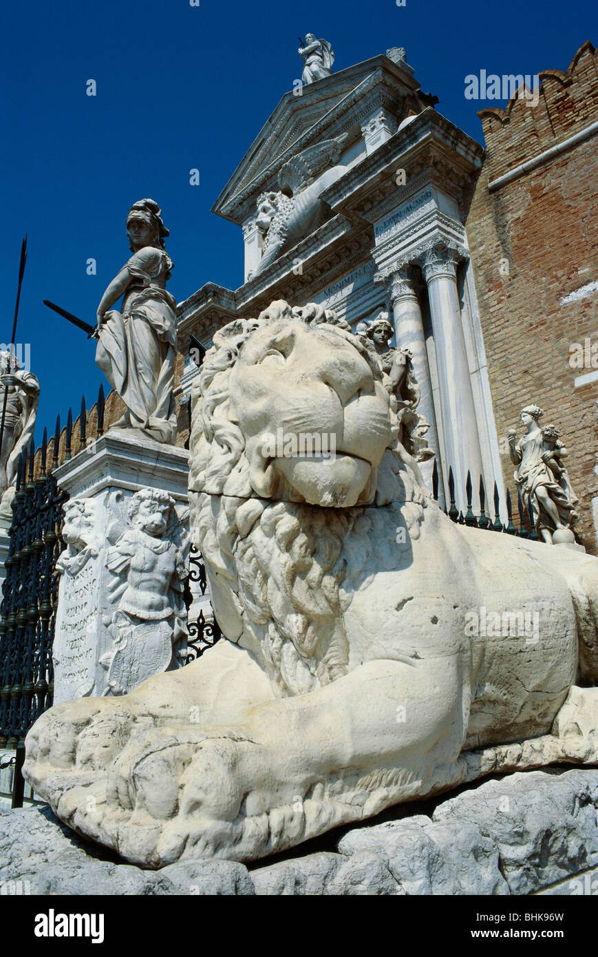 Venice. Italy. Lion statue stands on guard outside the gate of the Arsenale, the old shipbuilding yard. - Stock Image
