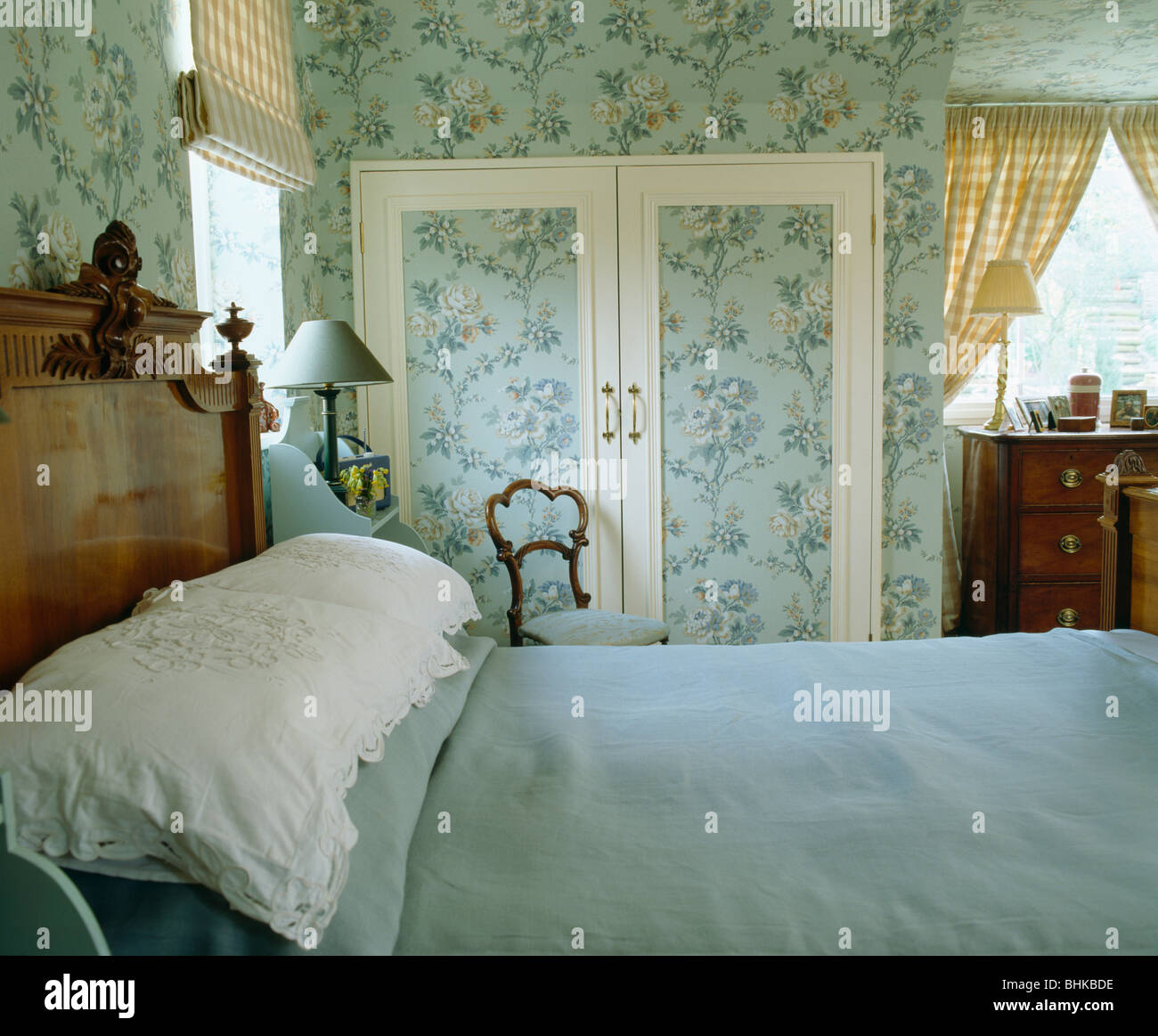 Blue Floral Wallpaper On Walls And Fitted Cupboard Doors