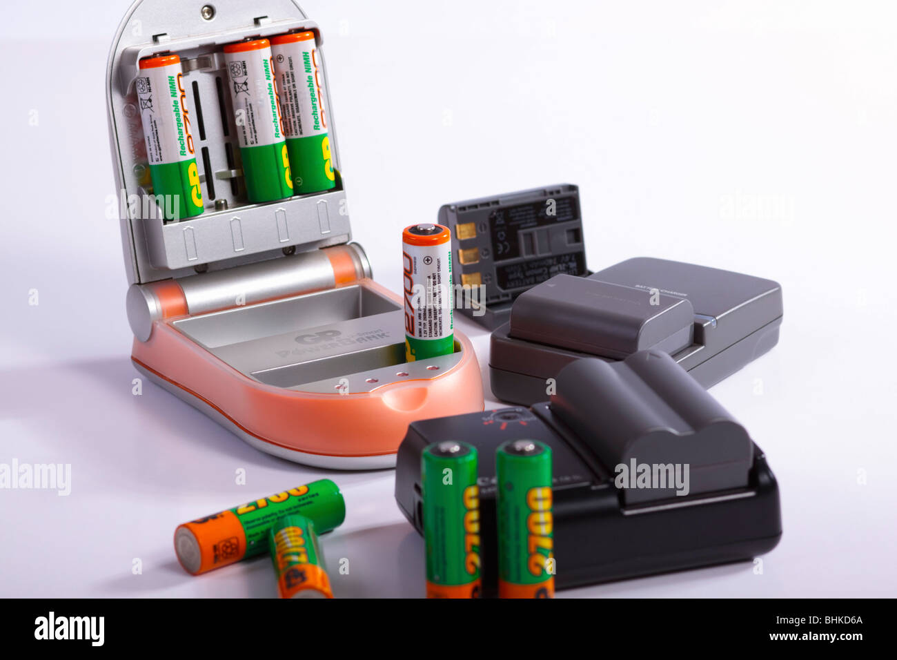 NiMH and Li-ion rechargeable batteries with chargers. Isolated. Stock Photo
