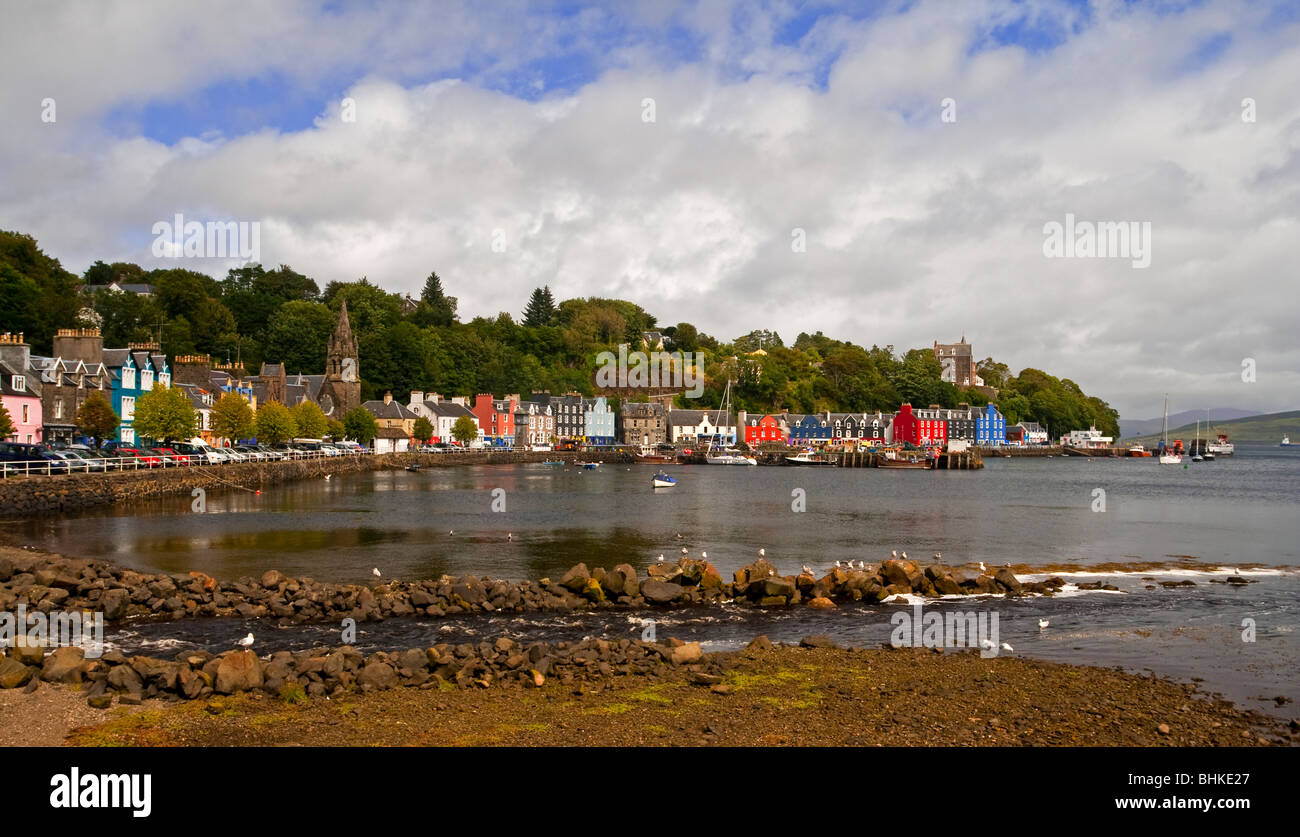 View of the brightly coloured shops and houses on the harbour front at Tobermory  a village on the Isle of Mull - Stock Image