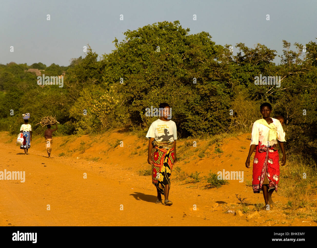 People walking home, Malindi, Kenya, Africa - Stock Image