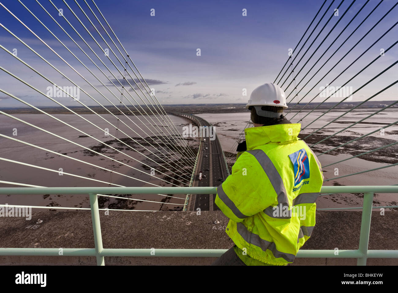 Maintenance worker on the Second Severn Crossing looking towards England. - Stock Image