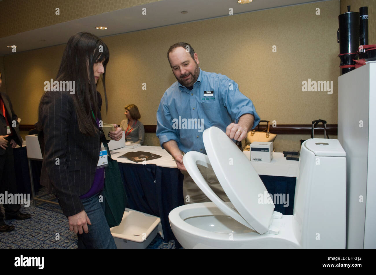 A representative from Kohler demonstrates their plumbing products at ...