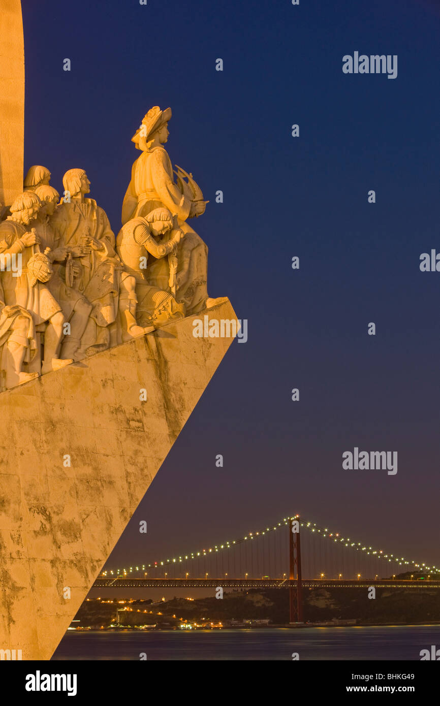 Portugal Lisbon Monument to the discoveries and suspension bridge at twilight - Stock Image