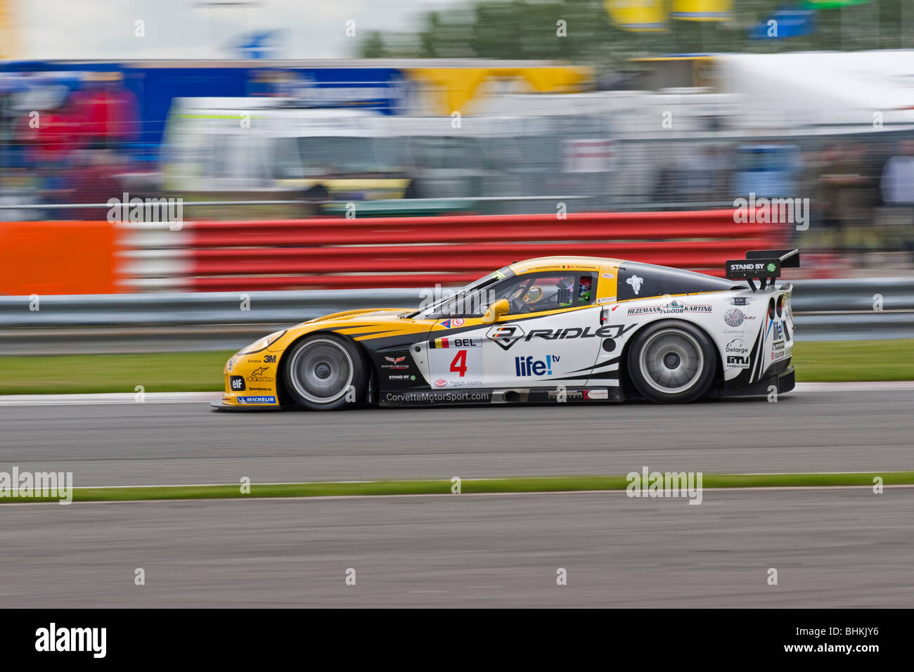 Chevrolet Corvette Z06 going around the bend at Copse at speed during the FIA GT Championship race. - Stock Image