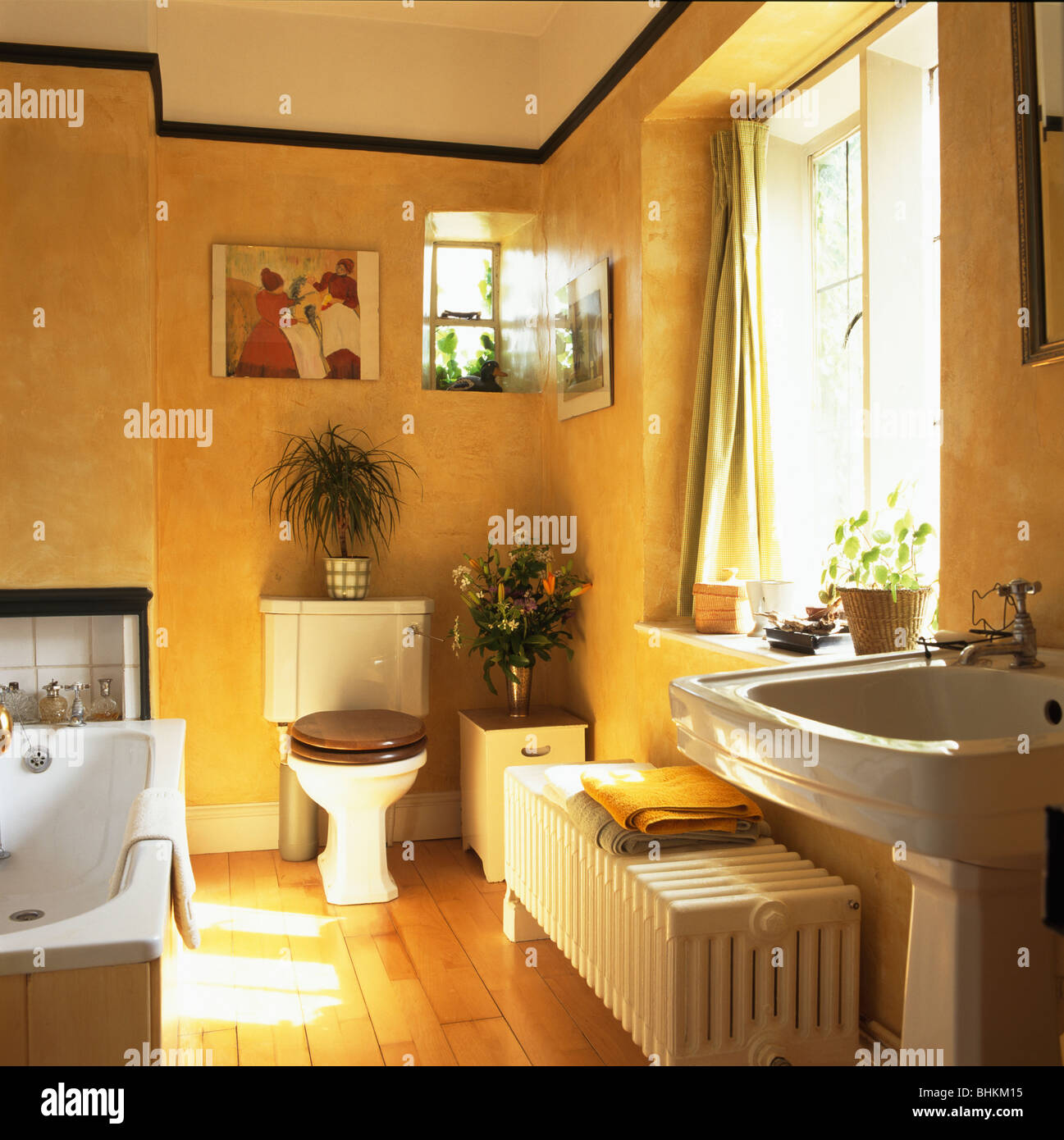 Large White Radiator And Wooden Flooring In Traditional Yellow Stock