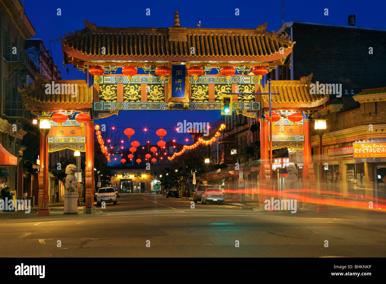 Gate of Harmonious Interest in Victoria Chinatown  at night decorated for Year of the Tiger-Victoria, British Columbia, - Stock Image