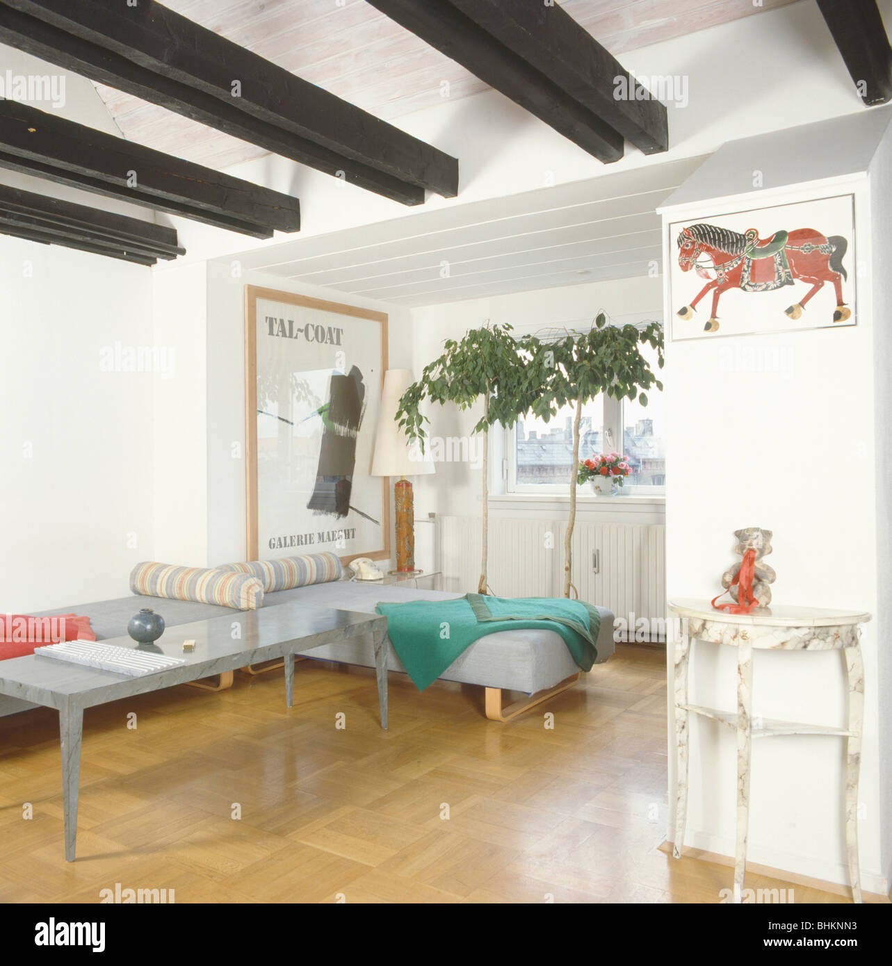Woodblock flooring and black ceiling beams in small loft conversion ...