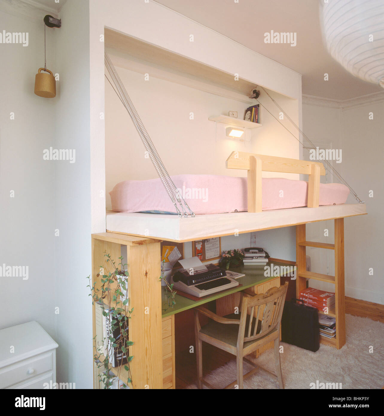 Pull Down Bed Above Desk And Chair In Bedroom In Economy Style Studentu0027s  Studio Apartment