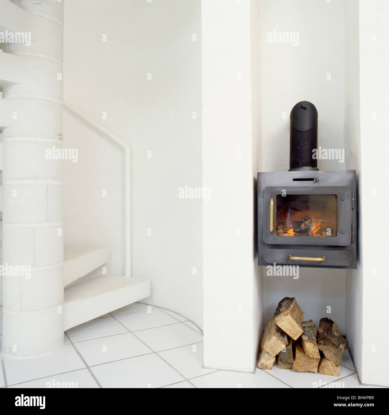 Amazing Wall Mounted Black Cast Iron Wood Burning Stove Above Pile Best Image Libraries Counlowcountryjoecom