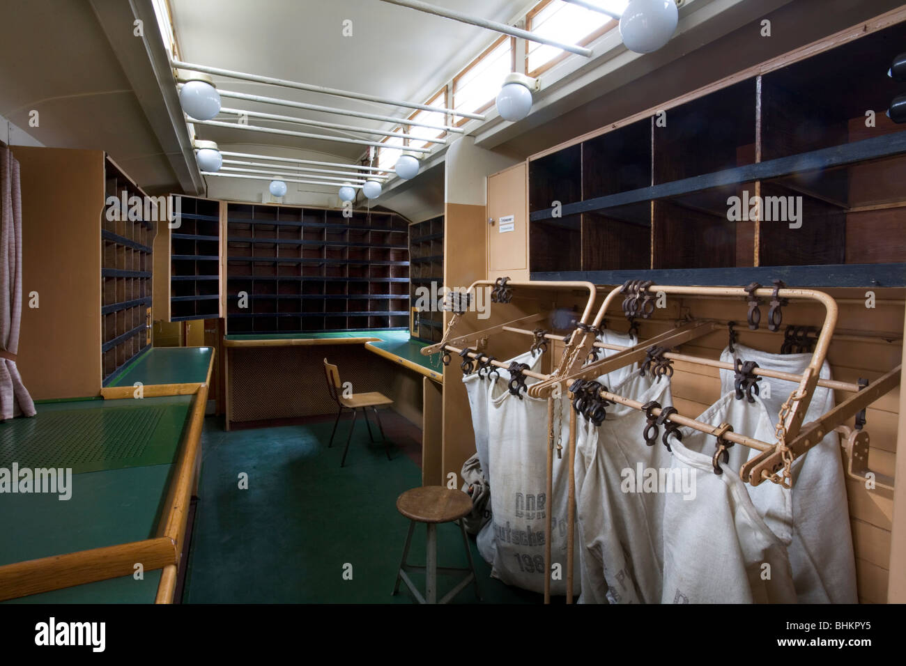 A 1950's Postal train coach, with mail bags and letter slots. Munich, Germany - Stock Image
