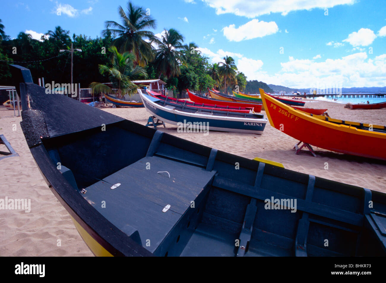 Fishing Boats Lined Up on a Beach, Aguadilla, Puerto Rico - Stock Image