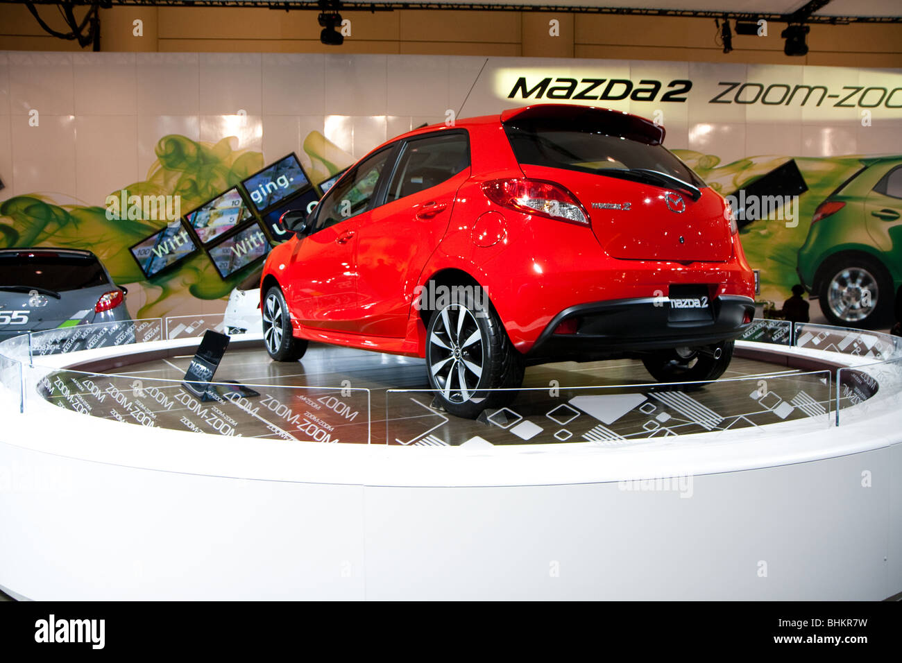 red mazda2 subcompact hatchback 2010 - Stock Image