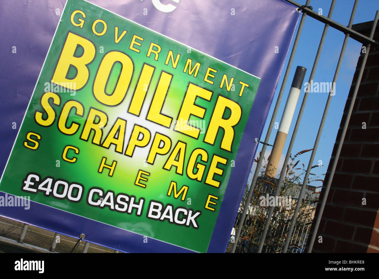 A banner advertising the U.K. Government's boiler scrappage scheme. - Stock Image