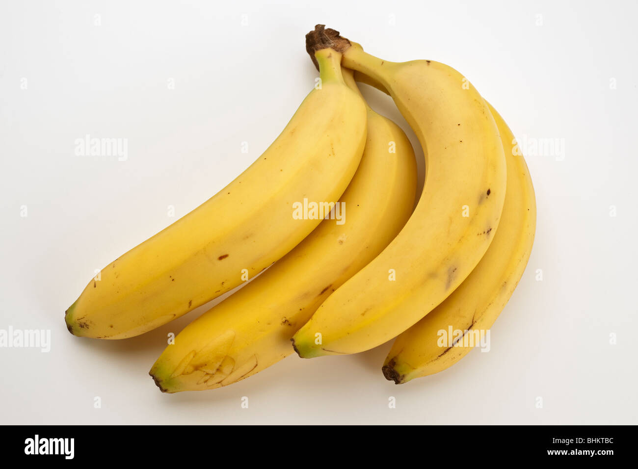 four joined yellow ripe bananas - Stock Image