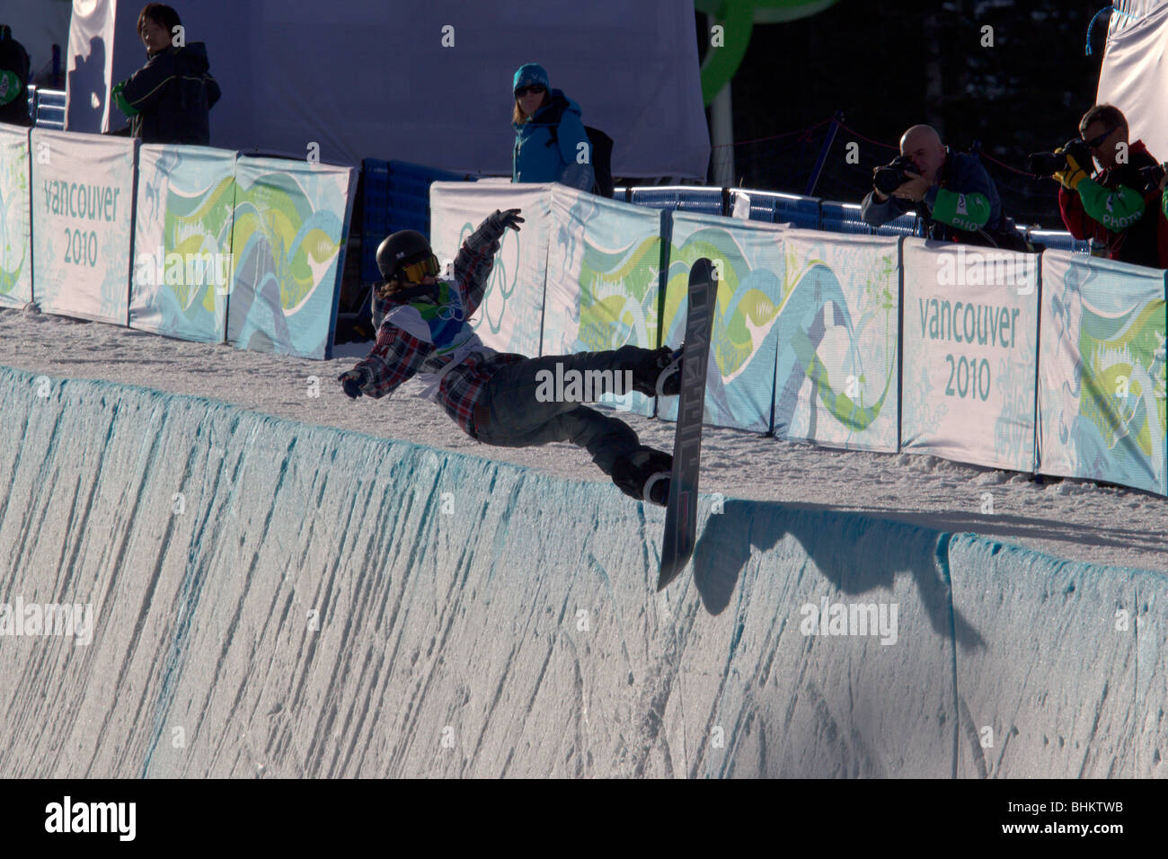 Louie Vito (USA) competing in the Men's Snowboard Halfpipe event at the 2010 Olympic Winter Games - Stock Image