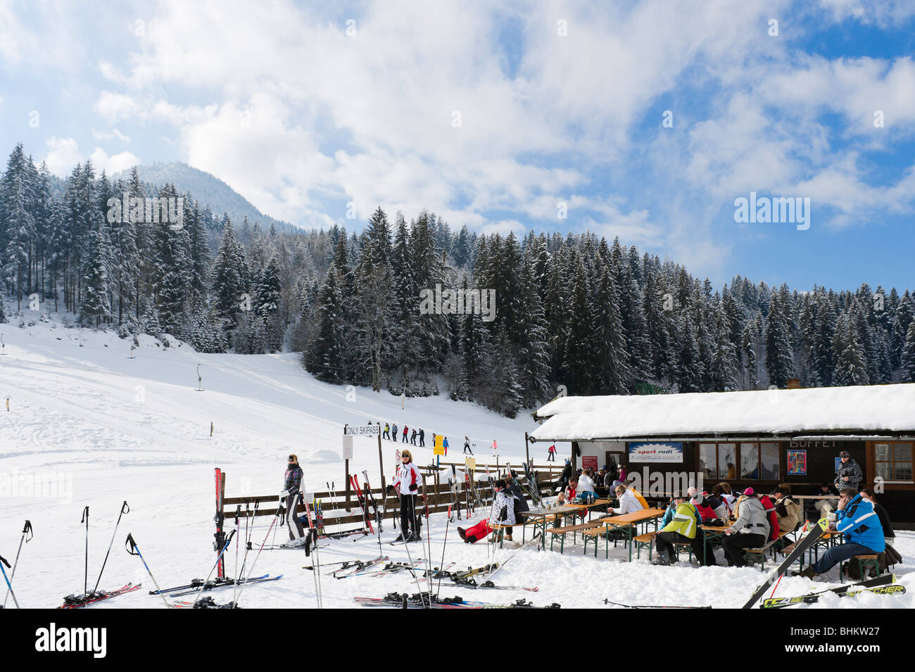 Drag lift and bar at the bottom of the slopes, Kirchberg, near Kitzbuhel, Tyrol, Austria - Stock Image