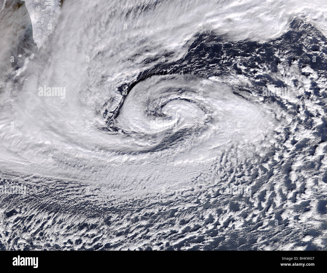 a strong low-pressure system could be seen whirling away just south of Kamchatka Peninsula and the Aleutian Islands. - Stock Image