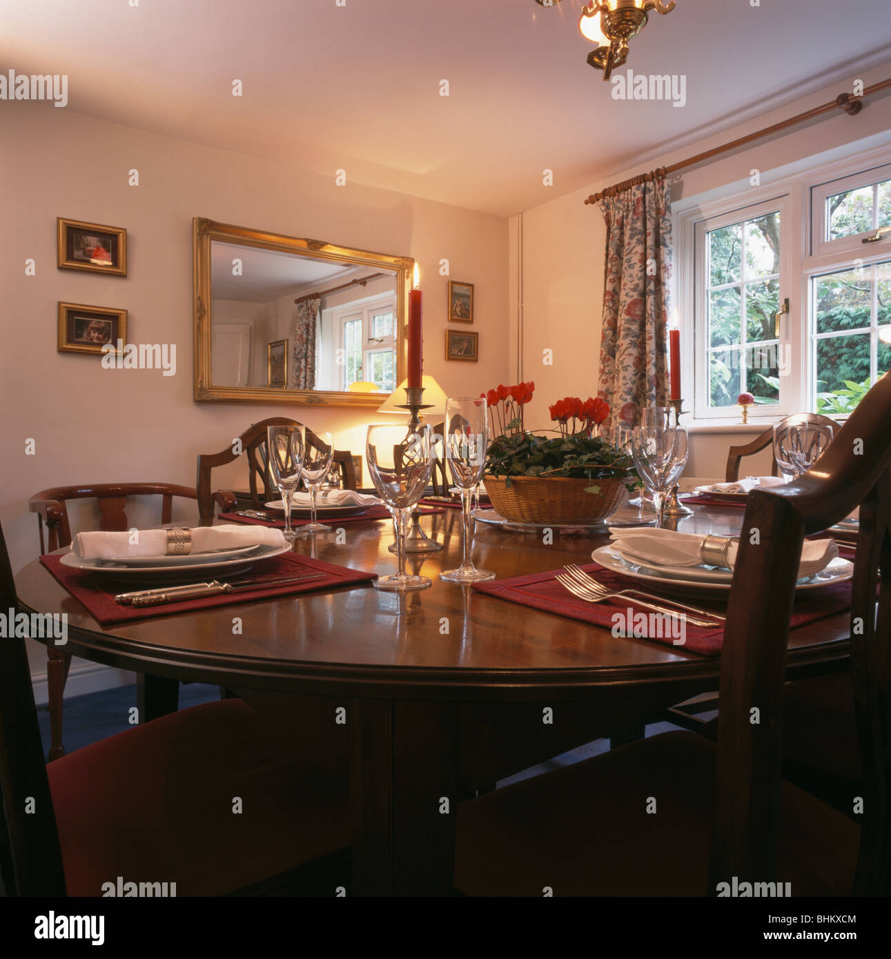 Rectangular Gilt Mirror In Traditional Dining Room With Wine Glasses Stock Photo Alamy