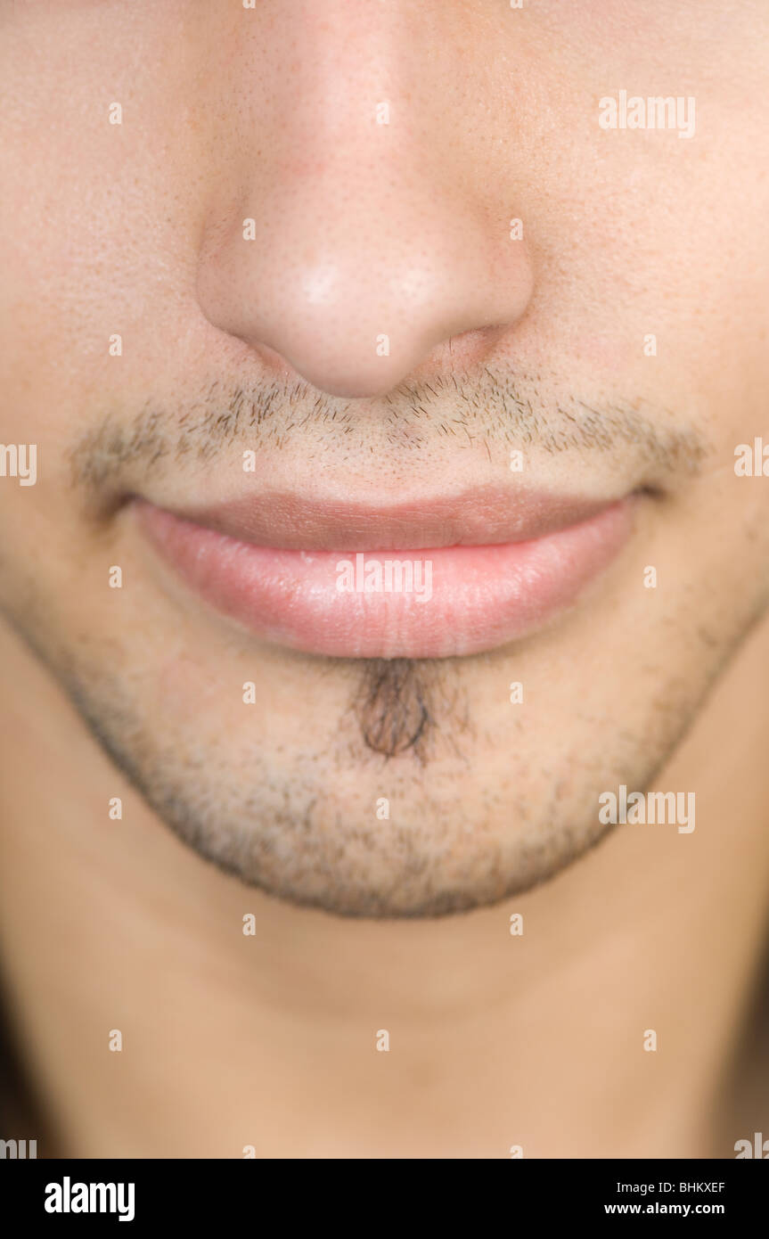 Close up of a young man's mouth and nose - Stock Image
