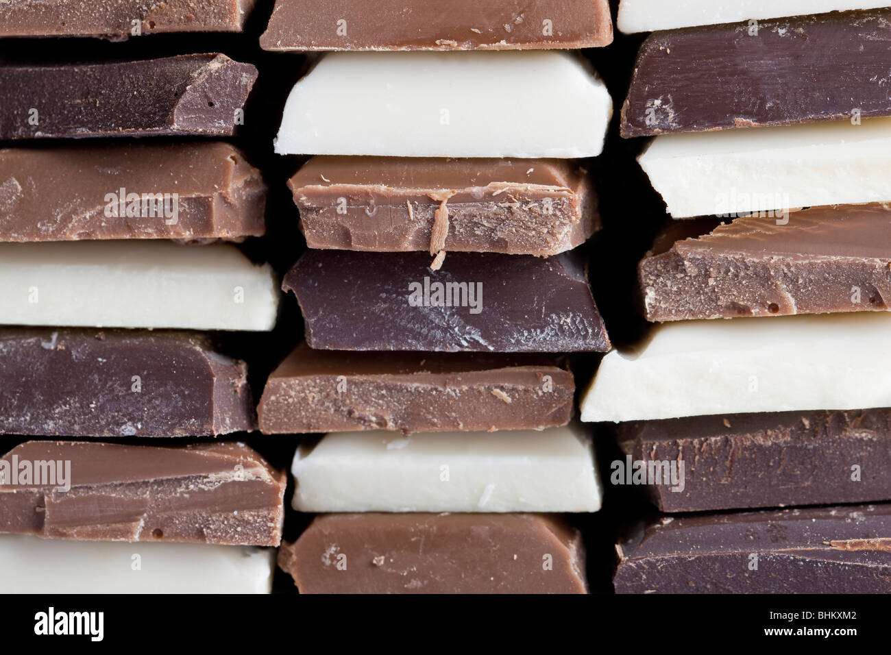 Many flavors of chocolate stacked up Stock Photo