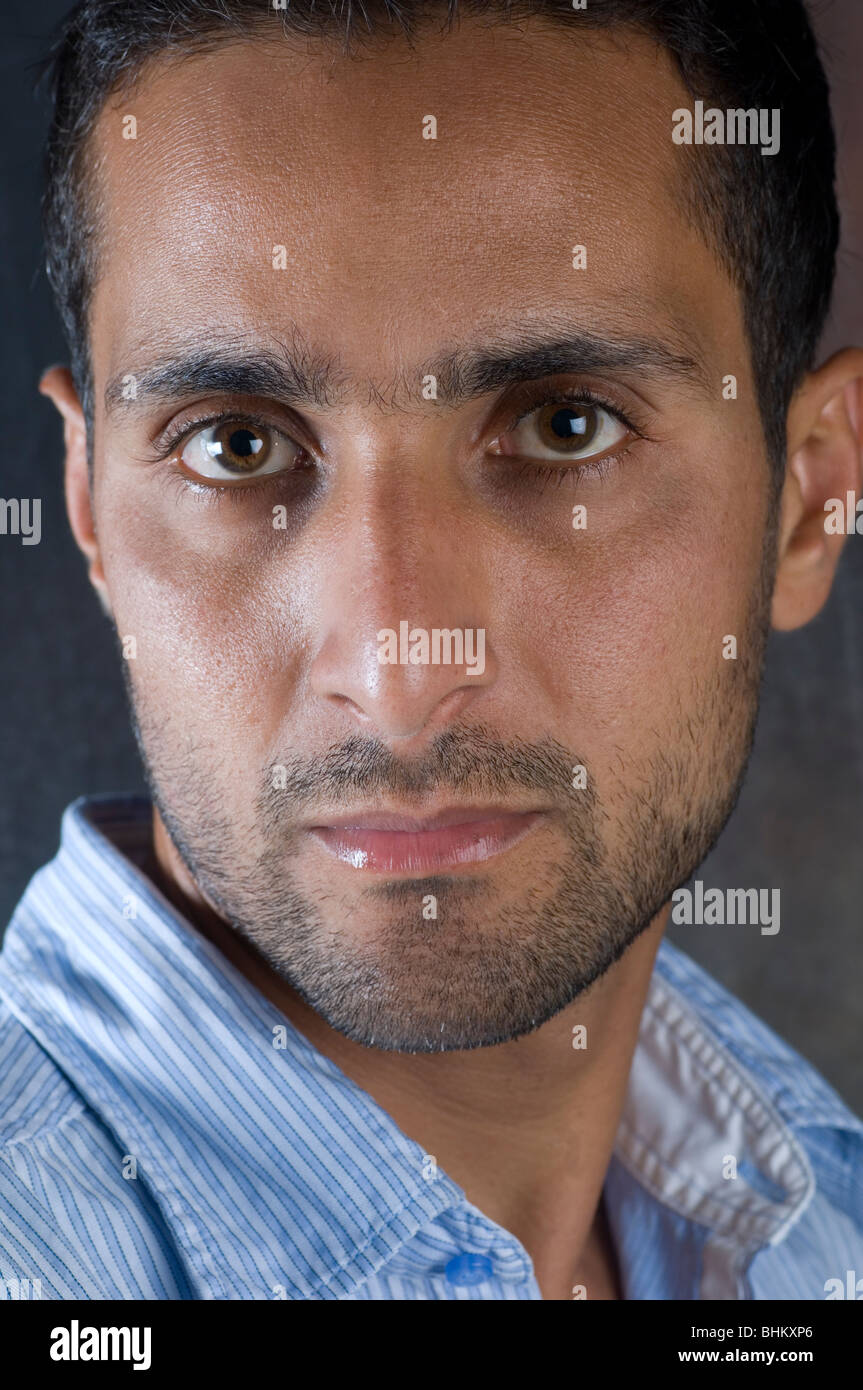 Closeup portrait of a young Arabic man looking at the camera Stock Photo