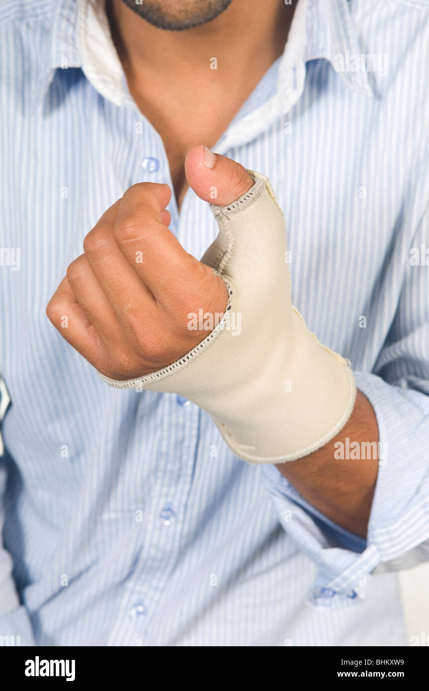 Close up of a man's hand with splint - Stock Image