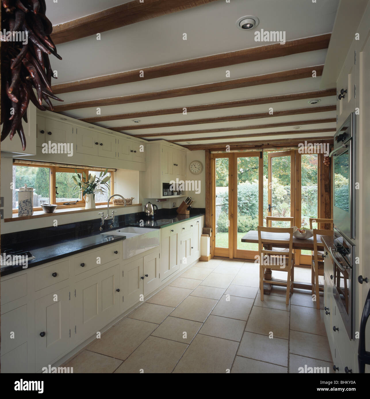 Cream Ceramic Floor Tiles In Country Kitchen With White Fitted Units Stock Photo Alamy