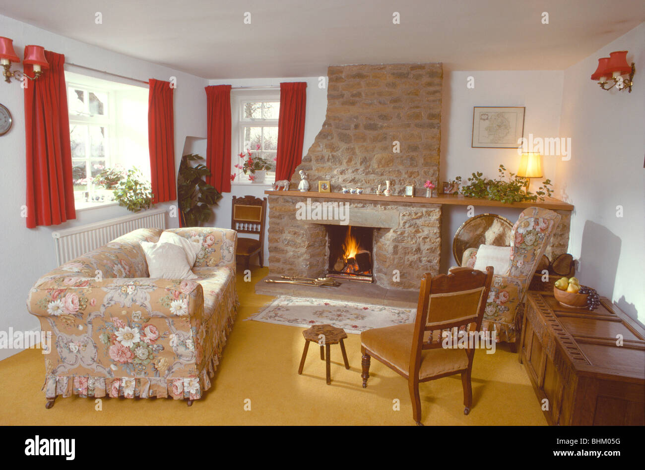 Floral Loose Cover On Sofa In Front Of Stone Fireplace With Lighted