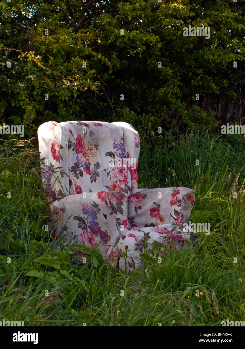 A Floral Upholstered Chair Dumped In A Field In North Devon.