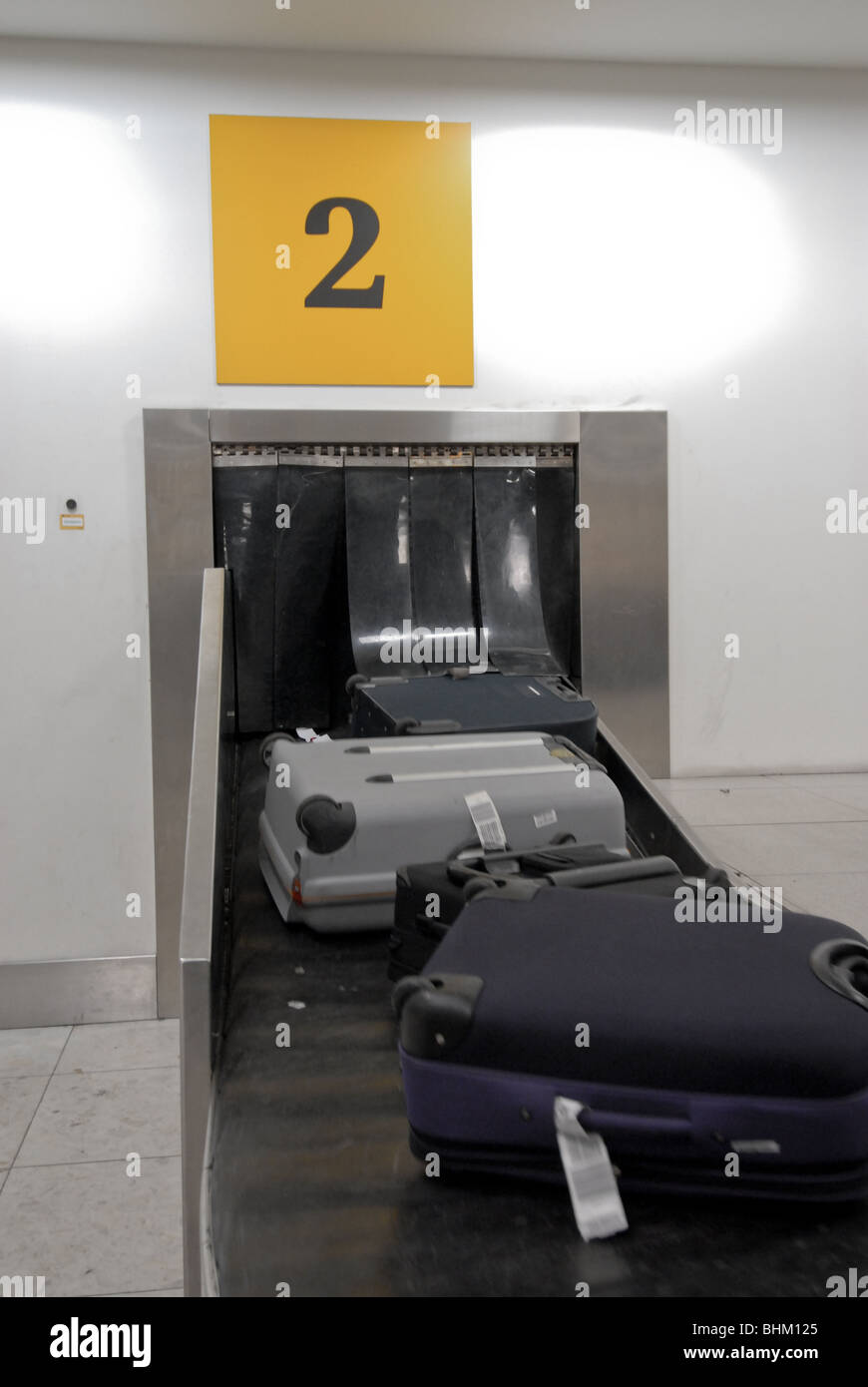 luggage on a conveyor belt - Stock Image