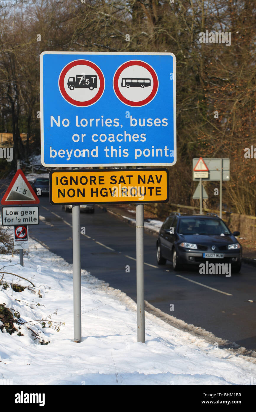 A road sign warns motorists not to follow satellite navigation devices on February 19, 2010 in the Forest of Dean, - Stock Image