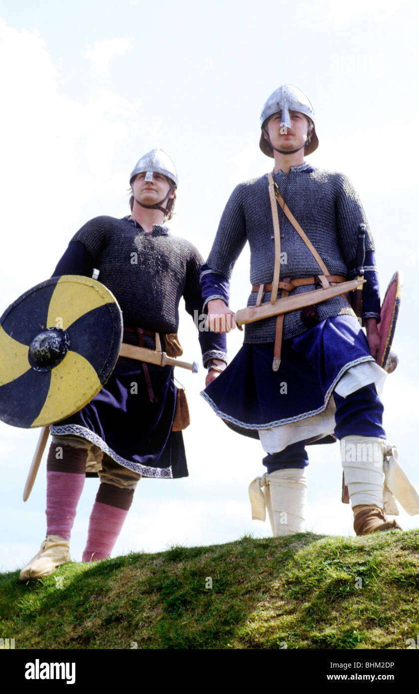 Norsemen Vikings Historical re-enactment English Saxon period history British England UK costume shield shields - Stock Image