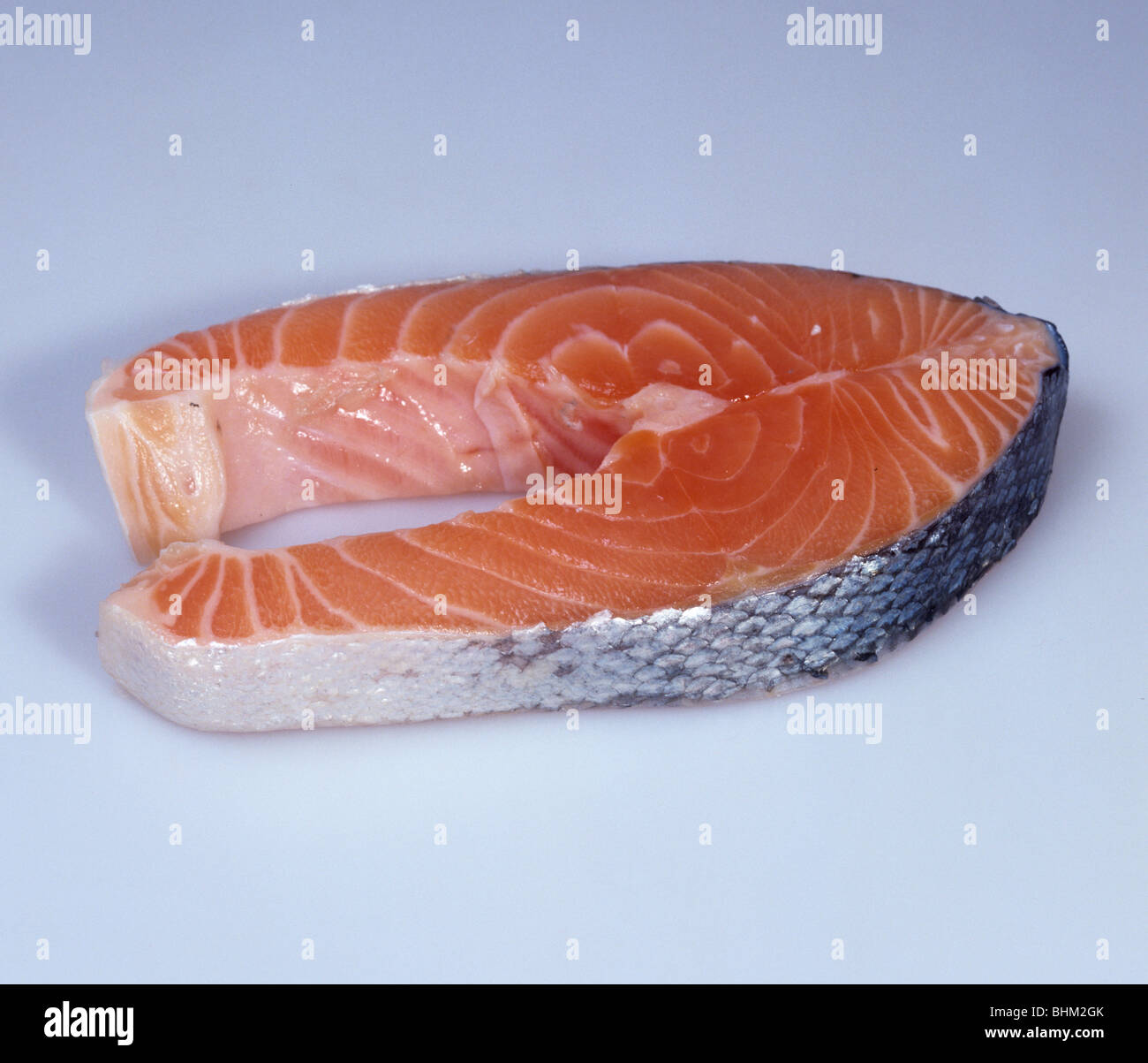 A smoked salmon steak, oily fish and a source of vitamin D and sodium - Stock Image