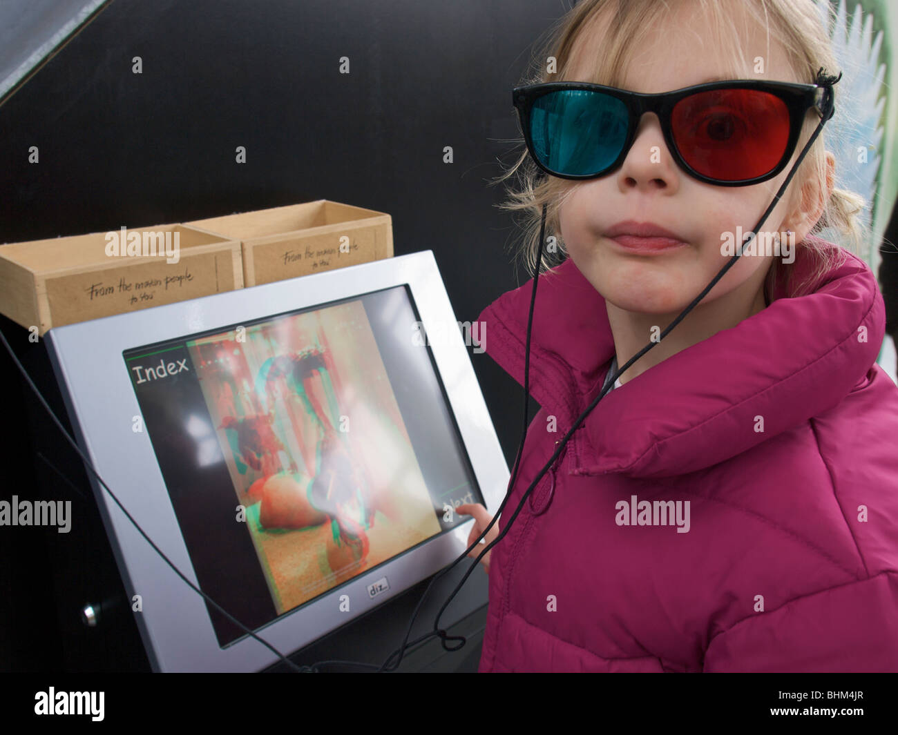 f930592ee30e Girl 5 years old wearing 3D glasses looking at museum slideshow on  touchscreen monitor. Boxtel, Noord Brabant, the Netherlands