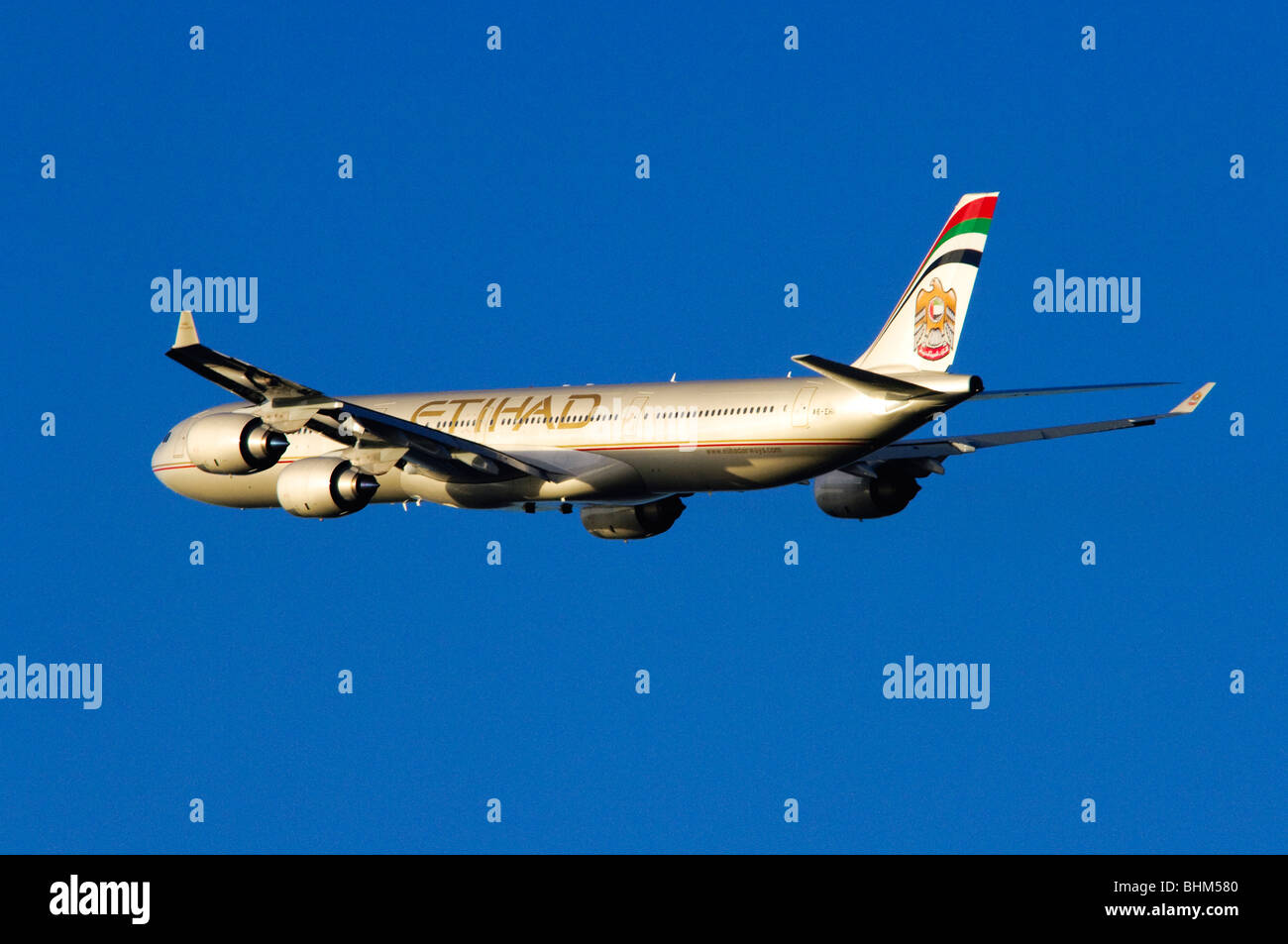 Airbus A340 operated by Etihad Airways climbing out from take off at London Heathrow Airport. Stock Photo