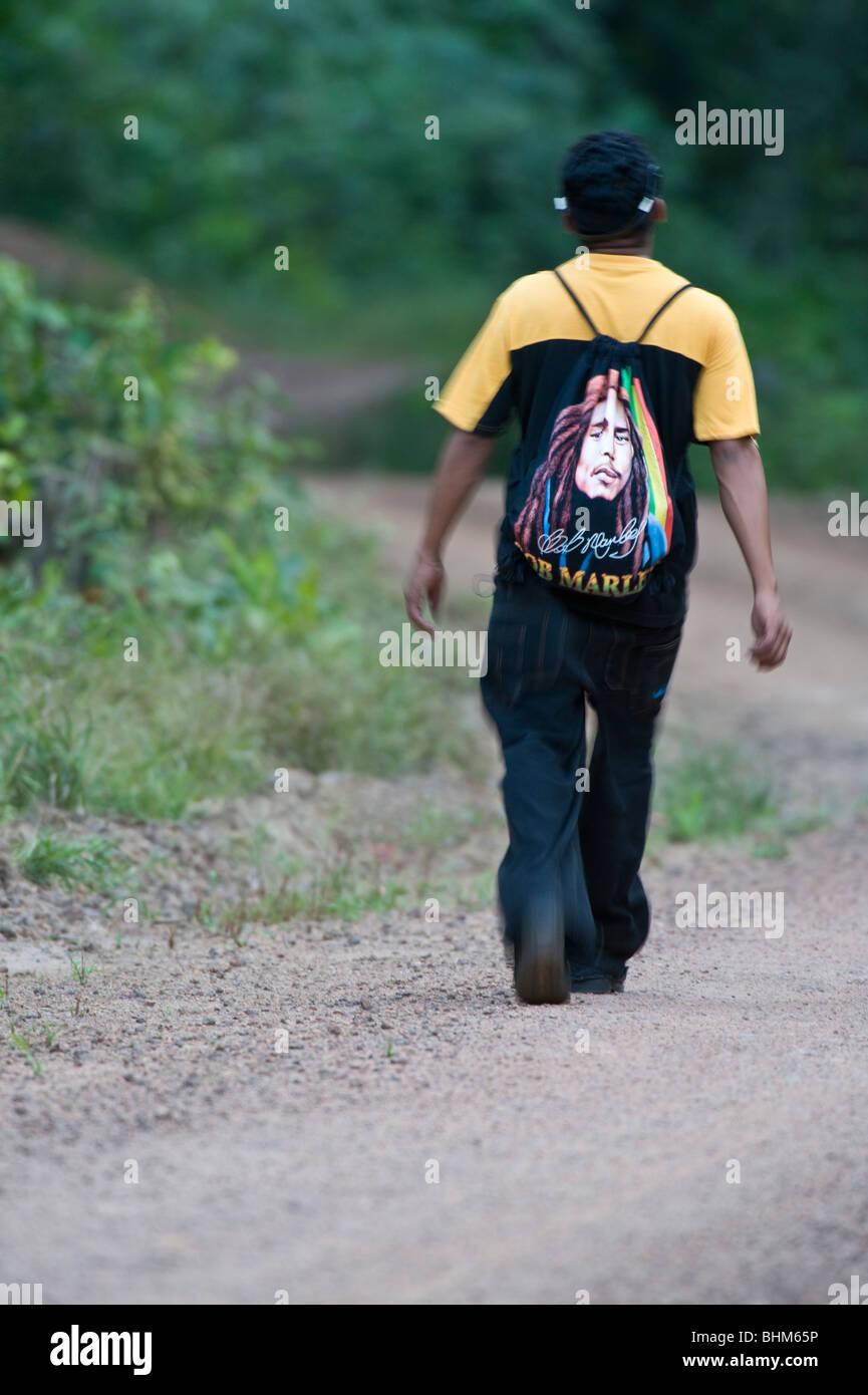 Amerindian man walking in Iwokrama Rainforest Guiana Shield Guyana South America October - Stock Image