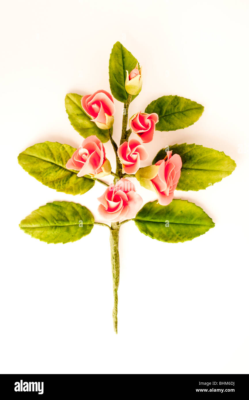 A sugar crafted flower for decorating a cake on a white background - Stock Image