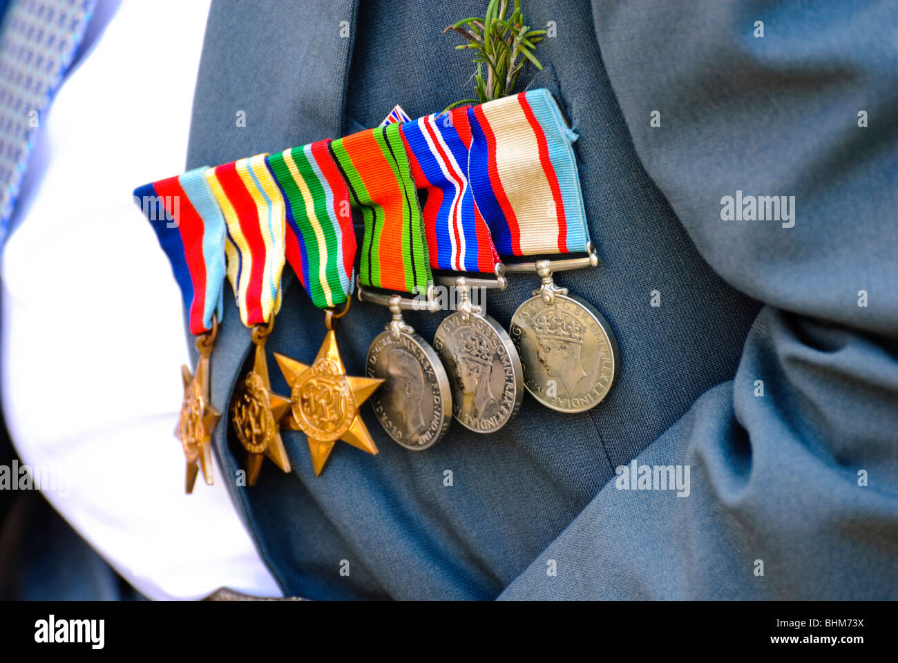 War medals, proudly worn by an older war veteran during an ANZAC Day parade, Australia. Brave military veteran proudly - Stock Image