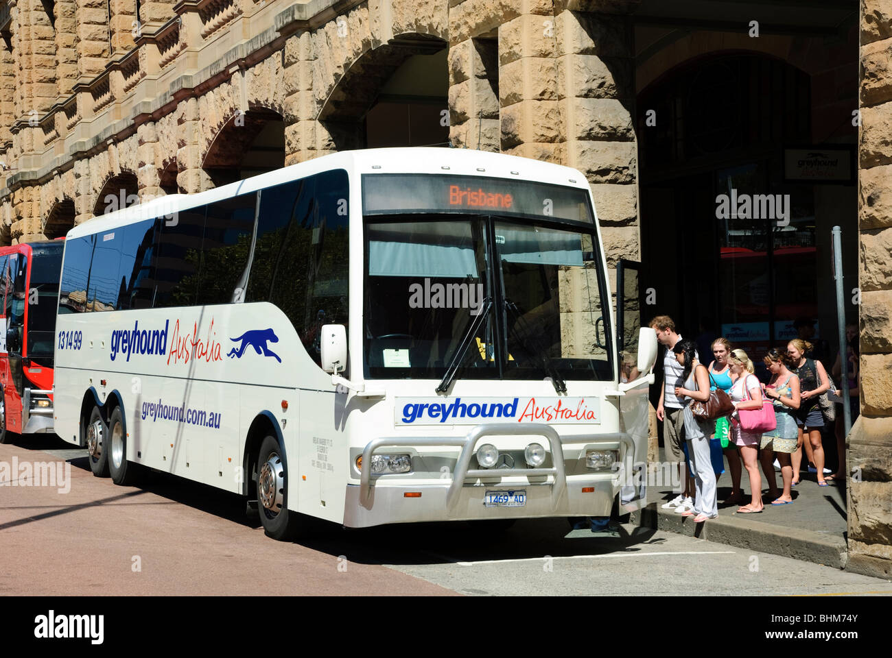 Long distance coach service: passengers board a bus at the beginning of a journey. Greyhound Australia; public transport; - Stock Image
