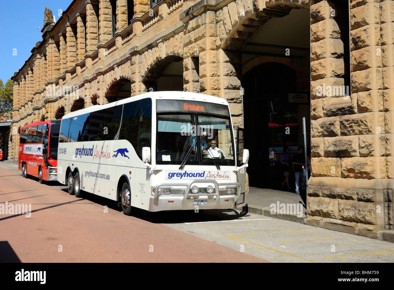 Greyhound long distance express bus / coach, waiting at the coach station. - Stock Image