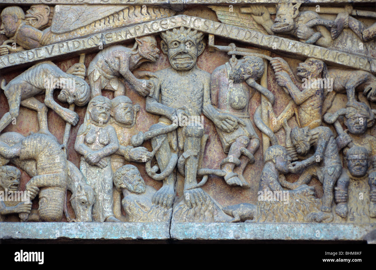 Satan or the Devil & the Chaos of Hell, c12th Romanesque Carving, Tympanam, West Facade, Sainte Foy Church, - Stock Image