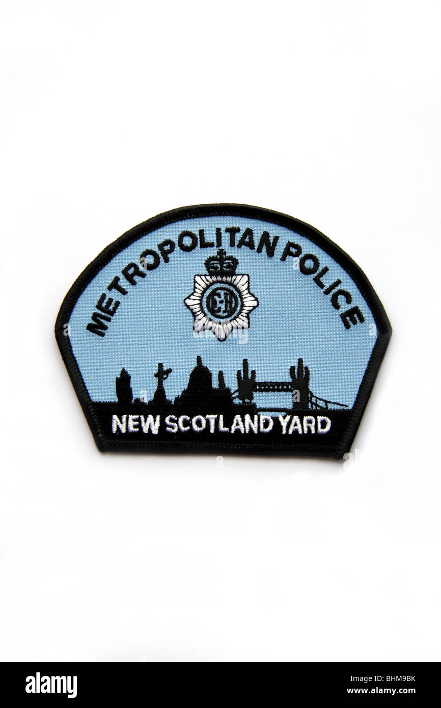 Patch of the Metropolitan Police New Scotland Yard with London skyline. - Stock Image