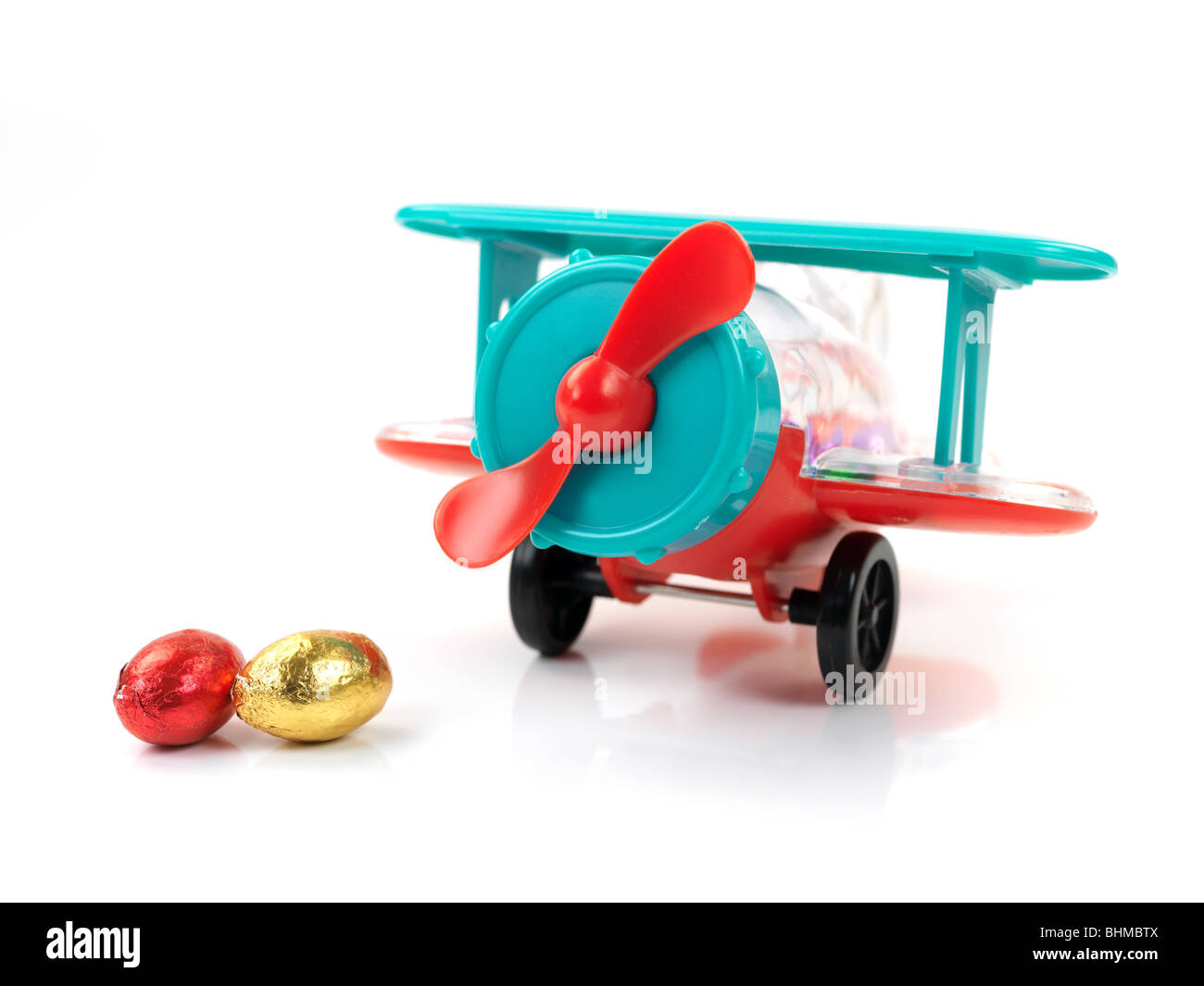 An aeroplane easter egg toy isolated against a white background - Stock Image