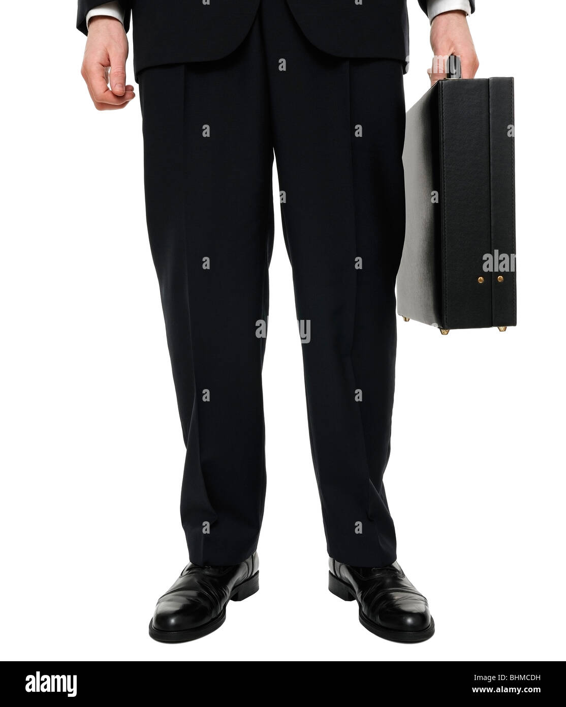 Businessman Standing with Briefcase, Low Section, Cut Out. - Stock Image