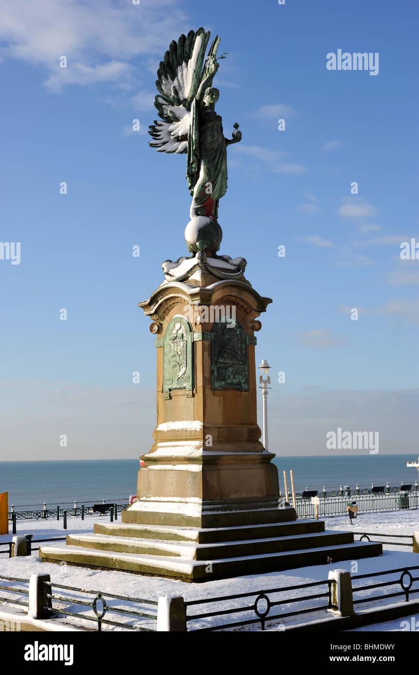 Brighton peace statue covered in snow Stock Photo