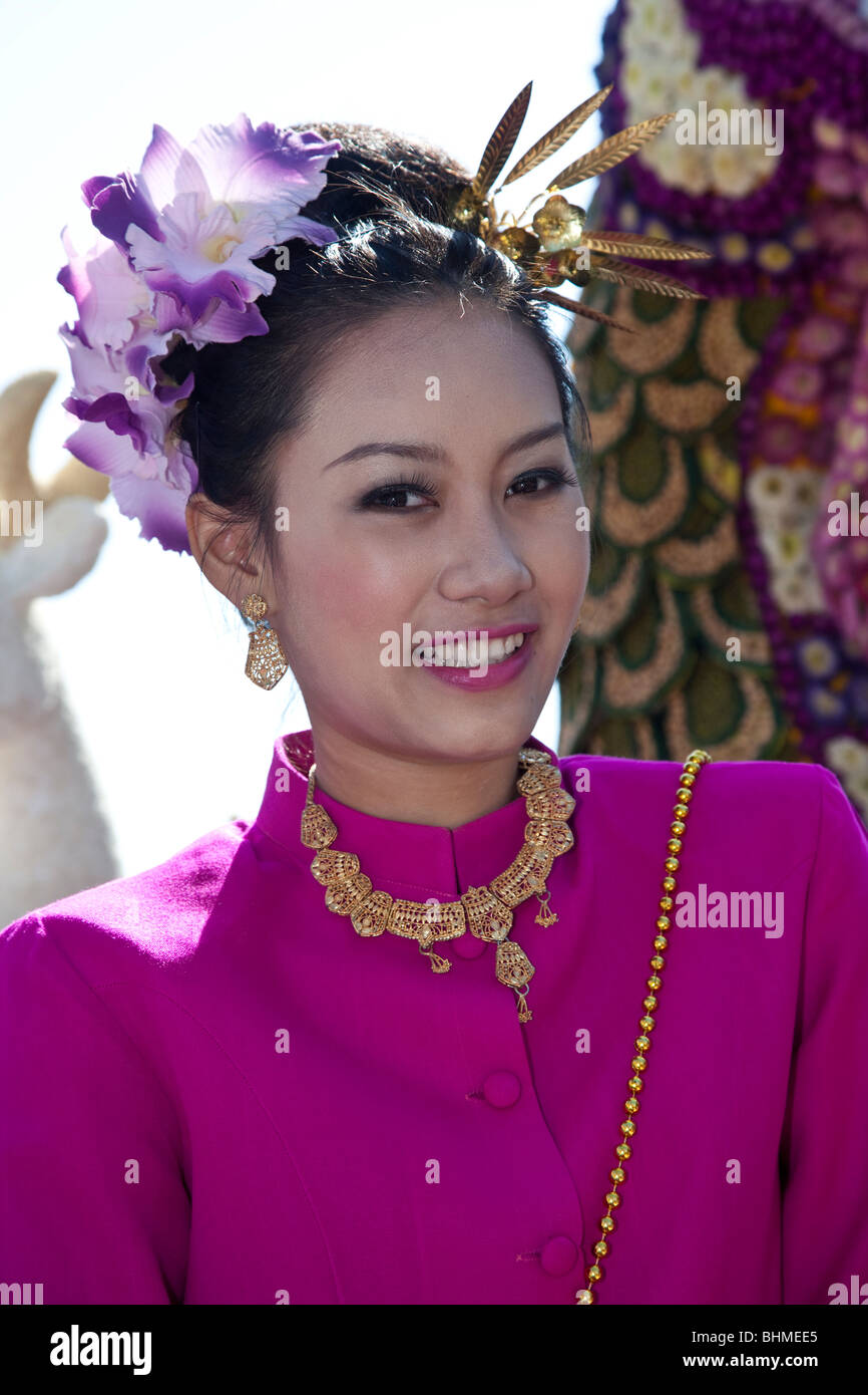 Flower display, Asian woman portrait floral art gaily decorated, bedecked, parade of show floats & colorful flowers; 34th Chiang Mai Flower Festival. Stock Photo