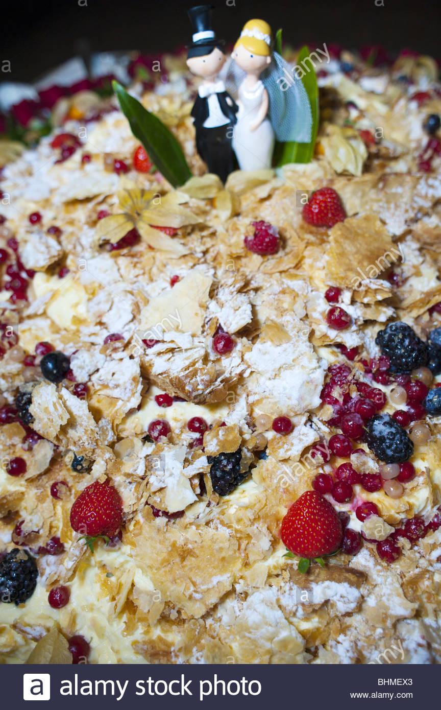 Fruit-covered wedding cake - Stock Image