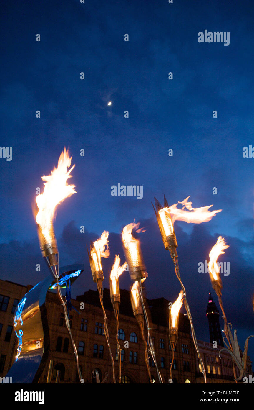 Burning torches against night sky during showzam annual festival in Blackpool - Stock Image